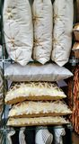 Stack of metalic coloured cushions. Retail. Colorful cushions displayed for sale Royalty Free Stock Photo
