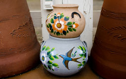 Stack of Mexican ceramic decorative pots between large terracott Royalty Free Stock Image