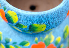 Stack of Mexican ceramic pots, blue background, orange flowers Stock Images