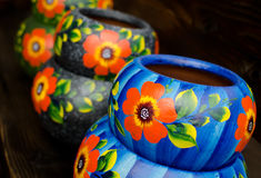 Stack of Mexican ceramic pots, blue and grey background. San Diego old town Stock Photo