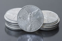 Stack of Mexican silver bullion coins Stock Photography