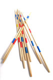 Stack of Mikado game wood sticks  on white background. Royalty Free Stock Photography