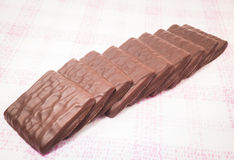 Stack of milk chocolate pieces Royalty Free Stock Photos