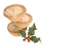 Stack of mince pies with holly Royalty Free Stock Photography