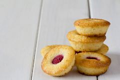 Stack of Mini Raspberry and Lemon Cupcakes - Horizontal Stock Photo