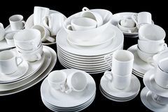 Mixed white dishes cups and plates isolated on black Royalty Free Stock Image