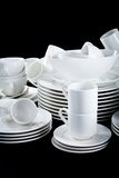 Mixed white dishes cups and plates isolated on black Royalty Free Stock Photo