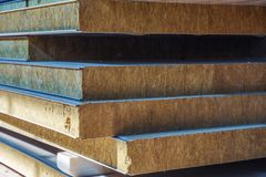 Stack of modern sandwich panel blocks from metal profile and wool foam for building warm and sound protected houses.  stock image
