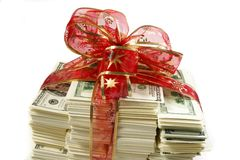 Stack of money. Wrapped in red bow and ribbon stock photos