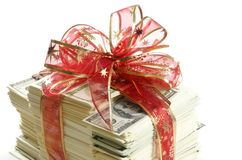 Stack of money. Wrapped in red bow and ribbon Royalty Free Stock Photos