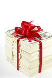 Stack of money. Wrapped in red bow and ribbon royalty free stock photo