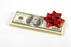 Stack of money american hundred dollar bills with red bow Royalty Free Stock Image