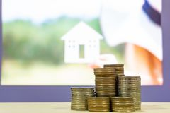 Stack of money with blur housing on background , finance concept stock image