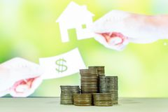Stack of money with blur housing on background , finance concept royalty free stock image