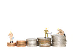 Stack money coin with Miniature worker. On white background Royalty Free Stock Photos