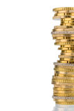 Stack of money coins in front of white background Royalty Free Stock Image