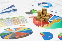 Stack of money coins are placed on the annual financial. Statements, concept of financial diagnosis Stock Images