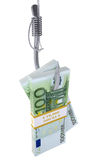 Stack of money on fishing hook Royalty Free Stock Photo