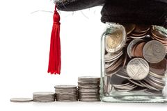 Stack of money and the glass jar of coin with square academic ca. P on white background for education financial concept stock photography