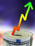 Stack of money with graph showing growth Stock Images