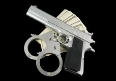 Stack of money, gun and handcuffs Royalty Free Stock Photo