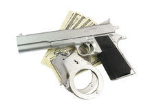Stack of money, gun and handcuffs Stock Photo