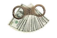 Stack of money and handcuffs. Isolated on white background Stock Photo