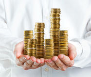 Stack of money in hands Stock Photo