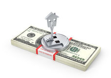 Stack of money with lock in form of house. Royalty Free Stock Photography