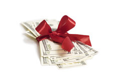 Stack of money. With red ribbon and golden coins royalty free stock photography