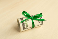 A stack of money with a ribbon. Expensive gift Stock Photo