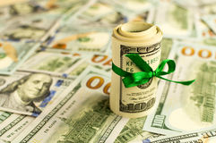 A stack of money with a ribbon. Expensive gift Stock Image