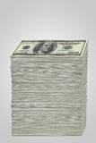 Stack of money. A tall stack of 100 US dollar bills Royalty Free Stock Photos