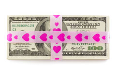 Stack of money tied up by pink ribbon with hearts. Stack of Money with pink ribbon  on a White Background Royalty Free Stock Photography