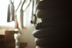Stack of moto tires in garage Stock Photos