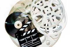 Stack of movie film reels with clapper Royalty Free Stock Photos