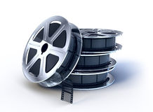 Stack of  movie films spool. With film Royalty Free Stock Photo