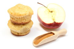 Stack of muffins, cinnamon and half an apple Stock Images