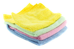 A stack of multi-colored towels stacked in the. Shape of a square on a white background Stock Photos