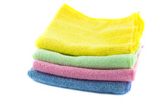 A stack of multi-colored towels stacked in the shape of a square. On a white background Royalty Free Stock Image