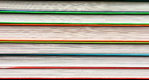 A stack of multicolored books. On a dark background stock photo