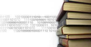 Stack of multicolored books. Old textbooks stacked on each other. Online education technology concept. E-learning. Training skill courses. Binary code data royalty free stock photos