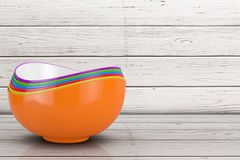 Stack of Multicolored Ceramic Food Bowls. 3d Rendering. Stack of Multicolored Ceramic Food Bowls on a wooden plank background. 3d Rendering stock illustration