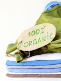 Stack of multicolored clothing  organic label Stock Images