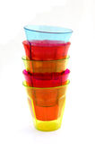 Stack of multicolored drinking glasses Stock Photo
