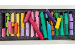 Stack of multicolored pastel chalks on box Stock Photography