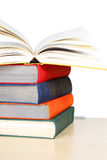 A stack of multicolored thick hardcover books. Isolated on white Stock Images