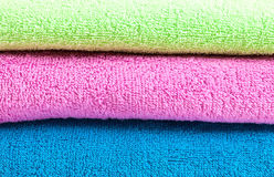 Stack of the multicolored towels Stock Photos