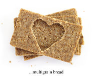 Stack of multigrain slices of bread, with cut out shape of heart Royalty Free Stock Images