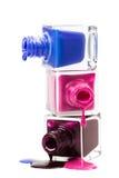 Stack of nail polish isolated on white background stock image
